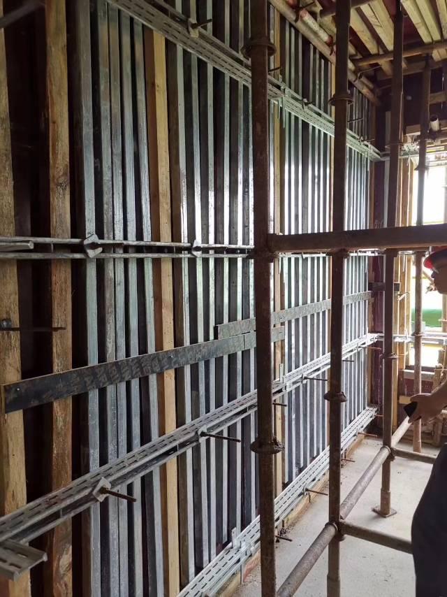 剪力墙加固件应用酒店大堂墙连柱高度9米加固完毕